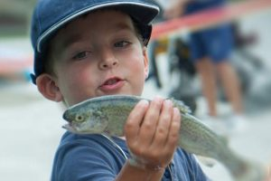 kid with a fish