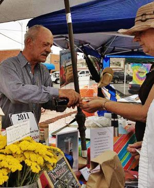 Steve Darland offering samples of Old Monticello Farms' organic balsamic vinegar