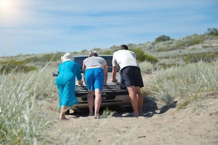 Pushing a car out of the sand at Elephant Butte Lake State Park