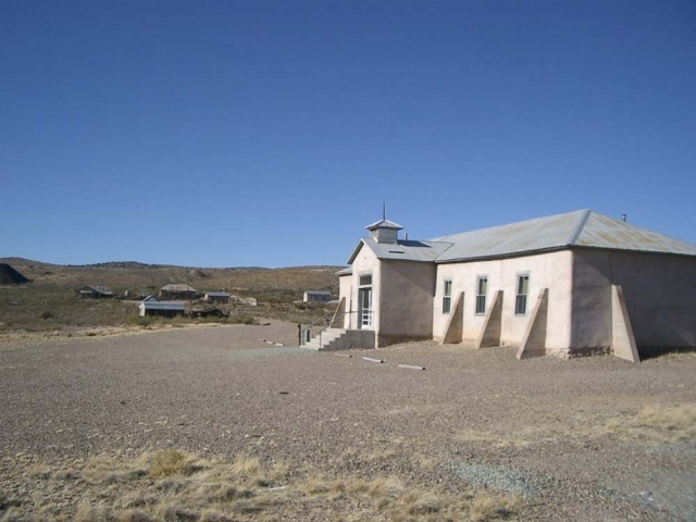 Lake Valley Schoolhouse with other buildings in the background