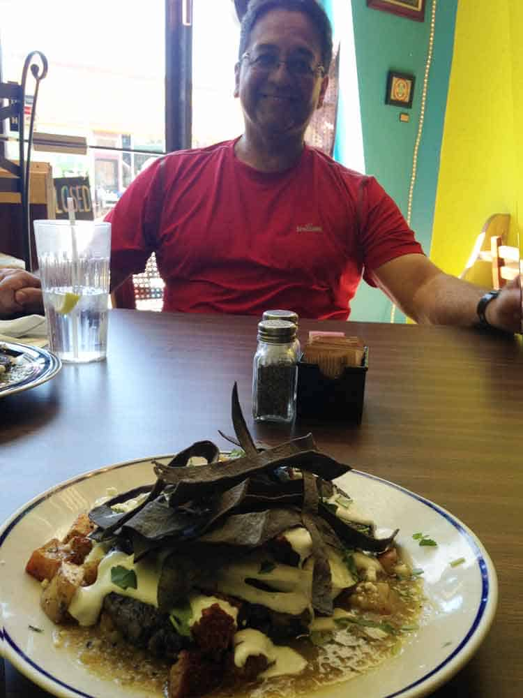 foreground: Grapevine Bistro Huevos Rancheros. Background: proprietor Mario Portillo