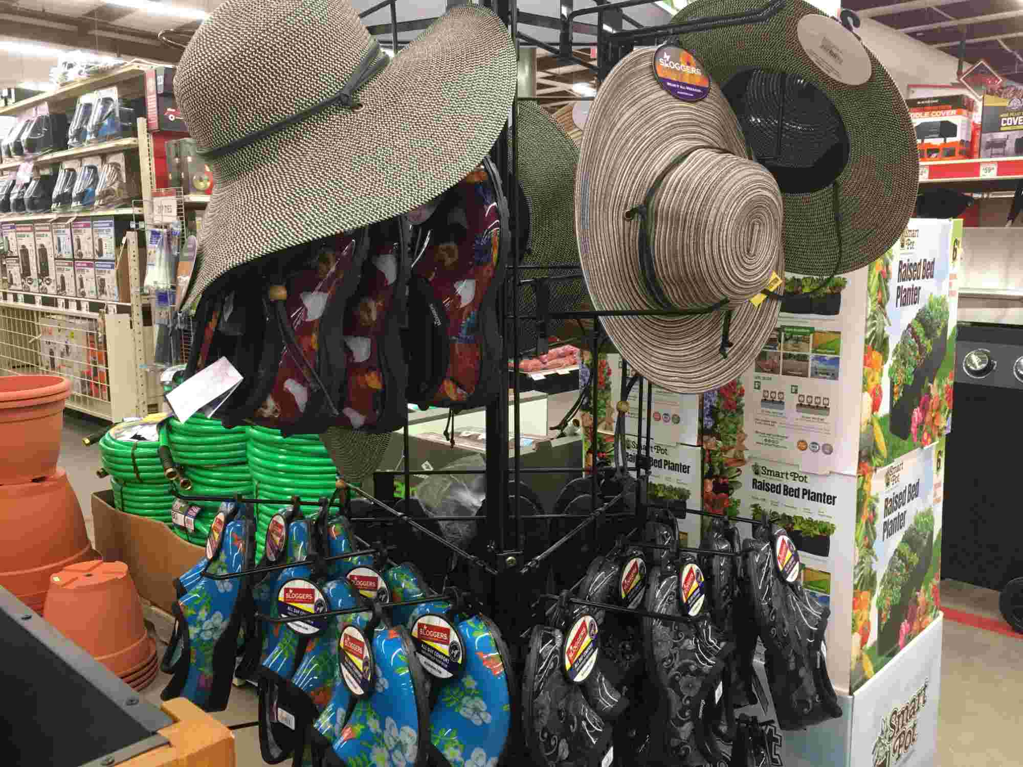 sun hats and garden sloggersyard decor at Tractor Supply in Truth or Consequences