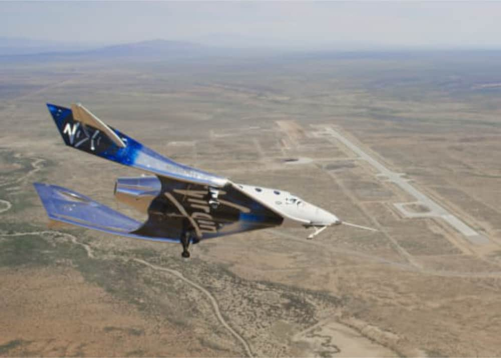 SpaceShipTwo glides over Spaceport America