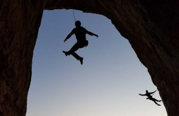rock climbing at the Caballo Bat Cave; photo courtesy of